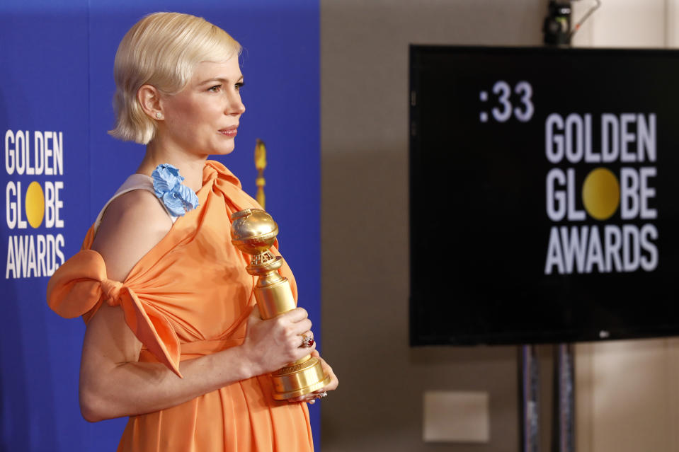"BEVERLY HILLS, CALIFORNIA - JANUARY 05: 77th ANNUAL GOLDEN GLOBE AWARDS -- Pictured: Michelle Williams, winner of the Best Performance by an actress in a Limited Series or a Motion Picture Made for Television for ""Fosse/Verdon"" poses in the press room at the 77th Annual Golden Globe Awards held at the Beverly Hilton Hotel on January 5, 2020. --  (Photo by Trae Patton/NBC/NBCU Photo Bank via Getty Images)"