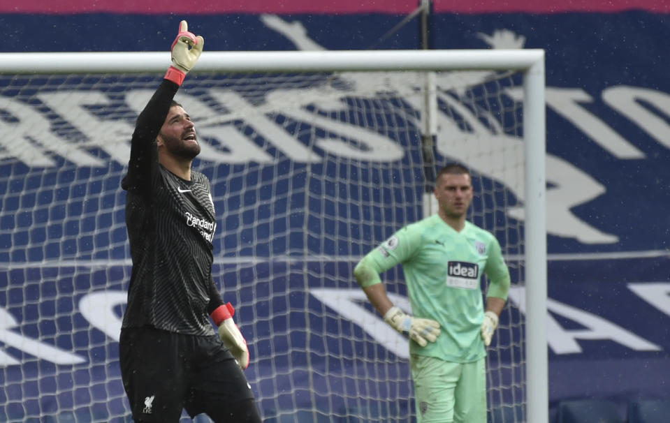 Liverpool's goalkeeper Alisson celebrates after scoring his side's second goal during the English Premier League soccer match between West Bromwich Albion and Liverpool at the Hawthorns stadium in West Bromwich, England, Sunday, May 16, 2021. (AP Photo/Rui Vieira, Pool)