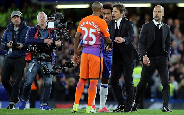 <span>Conte embraces Manchester City's Fernandinho </span> <span>Credit: Rex Features </span>