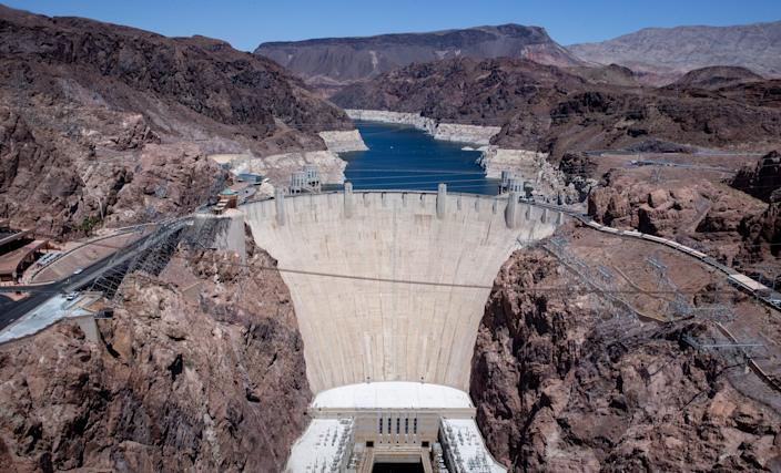 """Hoover Dam and Lake Mead photographed from the Mike O'Callaghan-Pat Tillman Memorial Bridge on May 10, 2021. A high-water mark or """"bathtub ring"""" is visible on the shoreline."""