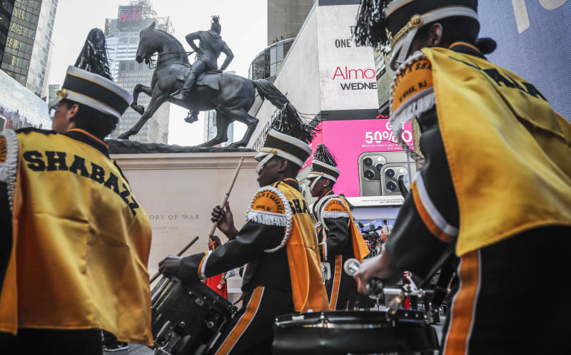 """Members of the Malcom Shabazz High School marching band, from Newark, N.J., perform at the the unveiling of artist Kehinde Wiley's sculpture """"Rumors of War"""" on Friday Sept. 27, 2019, in New York. The work, depicting of a young African American in urban streetwear sitting astride a galloping horse, will be exhibited through December 1.  (AP Photo/Bebeto Matthews)"""