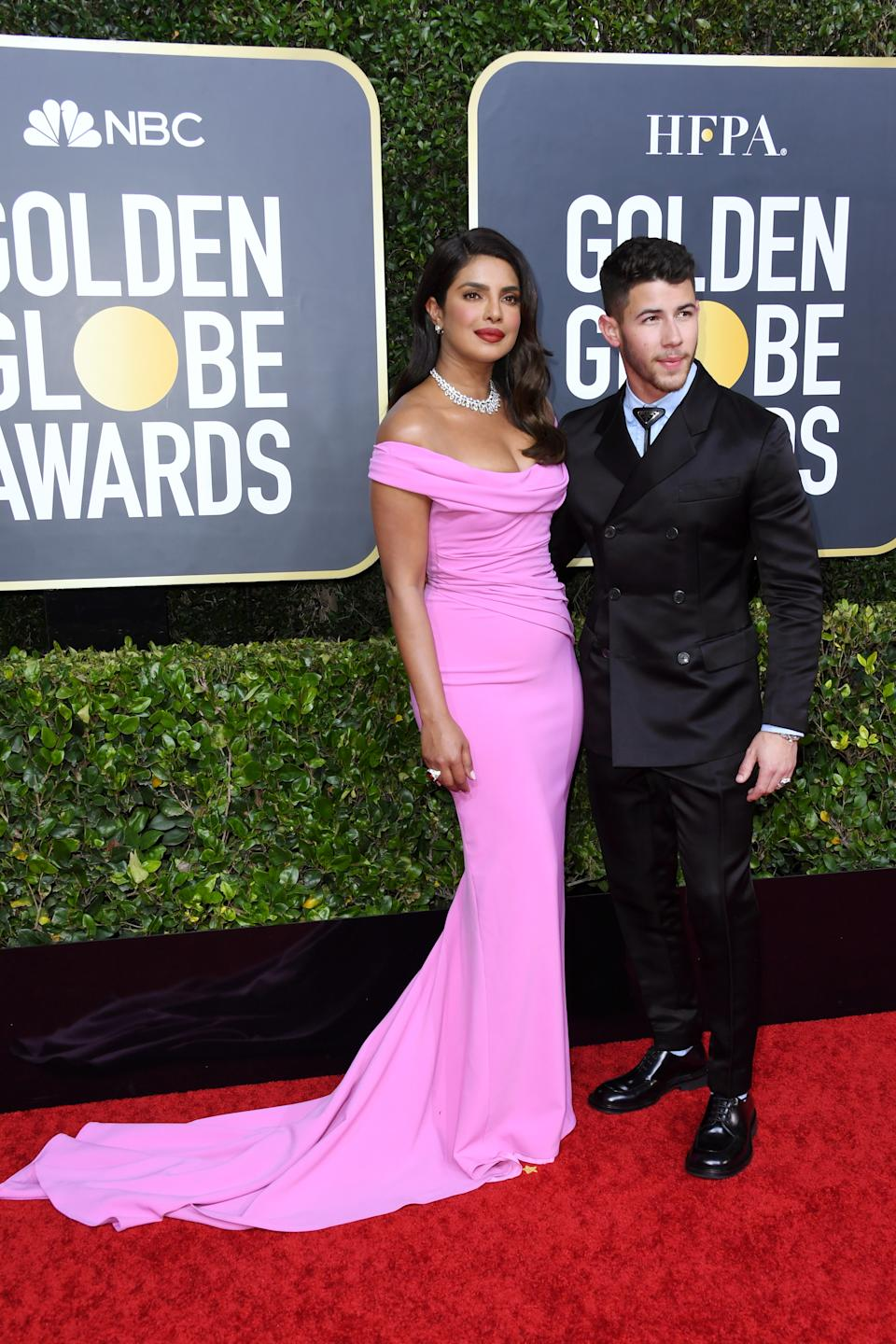 The A-list couple channelled old Hollywood glamour as they posed for the cameras. (Photo by Jon Kopaloff/Getty Images)