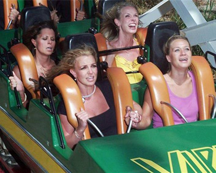 <p>Our favorite pop tart looked more annoyed (if looks could kill!) than scared when she went on a thrill ride at Six Flags Magic Mountain. She was in much better shape than the brunette behind her, who looked ready to toss her cookies. (Photo: Splash News) </p>