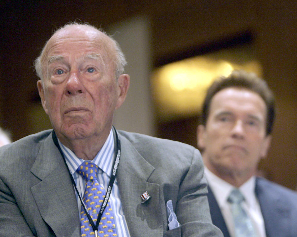 FILE - In this Aug. 14, 2008 file photo, former Secretary of State, George Shultz, left, and California Gov. Arnold Schwarzenegger, listen during the opening of the 26th Border Governors Conference, in Los Angeles. Shultz, former President Ronald Reagan's longtime secretary of state, who spent most of the 1980s trying to improve relations with the Soviet Union and forging a course for peace in the Middle East, died Saturday, Feb. 6, 2021. He was 100. (AP Photo/Nick Ut, File)