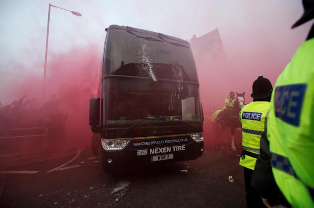 <p>Soccer Football – Champions League Quarter Final First Leg – Liverpool vs Manchester City – Anfield, Liverpool, Britain – April 4, 2018 Manchester City team bus arrives as Liverpool fans set off flares outside the stadium before the match Action Images via Reuters/Carl Recine </p>