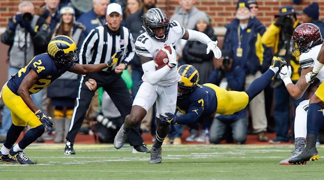 "<p>Michigan's 2018 recruiting class is, judging by the simplest measures available, a letdown. On National Signing Day, the Wolverines watched their top-ranked offensive line target, Berkeley (Fla.) Prep five-star Nicholas Petit-Frere, <a href=""https://www.si.com/college-football/2018/02/07/national-signing-day-nicholas-petit-frere-committment"" rel=""nofollow noopener"" target=""_blank"" data-ylk=""slk:sign with rival Ohio State"" class=""link rapid-noclick-resp"">sign with rival Ohio State</a> even after they practiced at his high school in advance of their bowl game on New Year's Day. <a href=""https://twitter.com/nickbaumgardner/status/961265421742612480"" rel=""nofollow noopener"" target=""_blank"" data-ylk=""slk:Within a half hour"" class=""link rapid-noclick-resp"">Within a half hour</a>, a coveted linebacker who'd been verbally committed to Michigan since June 2016, Lee County (Ga.) High's Otis Reese, had flipped to Georgia.</p><p>Those two decisions left the Wolverines' 2018 haul with zero players ranked in the top 100 in the nation and a team ranking of No. 21 in the nation, according to the 247Sports Composite. That team ranking is 16 spots better than that of the first class head coach Jim Harbaugh signed in Ann Arbor in February 2015, but Harbaugh had only one full month to assemble that group after being hired the previous December. By contrast, the Wolverines' '16 and '17 classes ranked eighth and fifth in the country, respectively, with higher average player ratings in both years (89.86 in '16, 91.20 in '17) than the '18 class's 88.75, according to the 247Sports Composite.</p><p>It would be misguided to ignore the possibility of the rankings underselling at least a few members of Michigan's 2018 haul. One intriguing possibility is Cameron McGrone, an outside linebacker out of Lawrence Central High in Indianapolis whom Rivals and Scout both rank outside the top 190 in the class of 2018 but whom 247Sports assessed a five-star rating in January after he bounced back from a knee injury suffered during his junior season to earn a spot on the <em>Indianapolis Star</em>'s Central Indiana Super Team as a senior. ""Some guys may check a couple boxes, but McGrone checks them all,"" <a href=""http://247sports.com/Article/Michigan-signee-Cameron-McGrone-earns-a-fifth-star-113839409"" rel=""nofollow noopener"" target=""_blank"" data-ylk=""slk:247Sports director of football recruiting Steve Wiltfong said of McGrone"" class=""link rapid-noclick-resp"">247Sports director of football recruiting Steve Wiltfong said of McGrone</a>.</p><p>Plus, although this player won't be filed away as part of Michigan's 2018 recruiting class, the Wolverines are bringing in one of the most esteemed prizes on the transfer market. In December, Ole Miss sophomore quarterback Shea Patterson, who passed for 2,259 yards and 17 touchdowns against nine interceptions over seven games for the Rebels last season, announced he would transfer to Michigan. Depending on whether he's granted immediate eligibility on appeal, Patterson could make a bigger instant impact than any class of 2018 recruit the Wolverines could have signed.</p><p>That said, as <a href=""https://twitter.com/SBNrecruiting"" rel=""nofollow noopener"" target=""_blank"" data-ylk=""slk:SB Nation's Bud Elliott"" class=""link rapid-noclick-resp"">SB Nation's Bud Elliott</a> has detailed using his <a href=""https://www.sbnation.com/a/cfb-preview-2017/blue-chip-ratio"" rel=""nofollow noopener"" target=""_blank"" data-ylk=""slk:Blue-Chip Ratio"" class=""link rapid-noclick-resp"">Blue-Chip Ratio</a>, today's national champions are fueled by four- and five-star recruits, and Michigan's 2018 class has seven fewer of those than its 2016 class did and 14 fewer than its 2017 class did, according to the 247Sports Composite. Part of that is a result of a lousy closing stretch that culminated with Petit-Frere picking Ohio State and Reese's flip to Georgia. On a recent episode of the Michigan site MGoBlog's podcast, founder Brian Cook was asked about Michigan's finish to the 2018 recruiting cycle. ""It's bad,"" he said. ""It's not good. It needs to be better.""</p><p>One of the most troubling aspects of the class has nothing to do with who Michigan received National Letters of Intent from on the first Wednesday of February. It's who signed on with other Big Ten East heavyweights. Ohio State (No. 2) and Penn State (No. 5) both inked classes ranked in the top five nationally, with 19 top-100 high school players combined, according to the 247Sports Composite. The Buckeyes and Nittany Lions now <a href=""http://www.sbnation.com/college-football-recruiting/2018/2/8/16990550/college-football-recruiting-rankings-2018-class"" rel=""nofollow noopener"" target=""_blank"" data-ylk=""slk:check in first and eighth, respectively, in Bill Connelly's two-year recruiting rankings"" class=""link rapid-noclick-resp"">check in first and eighth, respectively, in Bill Connelly's two-year recruiting rankings</a>, compared to 15th for Michigan.</p><p>Those numbers reflect the grim reality that the Wolverines' recruiting downturn in the 2018 cycle coincided with a pair of Big Ten East competitors infusing their rosters with a lot of top-end prospects. As two of Michigan's biggest obstacles to national contention—whose College Football Playoff aspirations are in direct conflict with the Wolverines' by virtue of their residence in the same division—were putting the finishing touches on classes stuffed with elite high schoolers, Michigan was building a strong candidacy for <a href=""https://www.si.com/college-football/2018/02/07/national-signing-day-winners-losers-recruiting-class-grades"" rel=""nofollow noopener"" target=""_blank"" data-ylk=""slk:the ""loser"" columns of media outlets' NSD postmortems"" class=""link rapid-noclick-resp"">the ""loser"" columns of media outlets' NSD postmortems</a>.</p><p>The MGoBlog discussion touched on the notion that the Wolverines' 2018 recruiting may well have been affected by a season that included losses to the four Big Ten teams ranked above them in Football Outsiders' final S&P+ ratings (Ohio State, Penn State, Wisconsin, Michigan State) and ended with a total dud, a 26–19 defeat to South Carolina in the Outback Bowl that dropped the Wolverines' win-loss record to 8–5. Their underwhelming efforts on fall Saturdays, unsurprisingly, did not seem to help matters on the recruiting trail.</p><p>Only one of the players in Michigan's 2018 class who issued his verbal pledge after July, according to Rivals' tracking of the program's commitments, ranked better than 25th at his respective position in the 247Sports Composite: Ridge Point (Tex.) High tight end Mustapha Muhammad. Harbaugh's efforts to add an offensive tackle prospect to that list were foiled when Mission Viejo (Calif.) High four-star offensive tackle Jarrett Patterson reportedly cut Michigan from his list of schools in late January (he later committed to Notre Dame) and Petit-Frere picked Ohio State on signing day. (It's worth mentioning that Michigan is still in the mix for <a href=""http://www.si.com/college-football/2018/02/01/calvin-anderson-rice-transfer-texas-michigan-auburn"" rel=""nofollow noopener"" target=""_blank"" data-ylk=""slk:highly touted Rice graduate transfer tackle Calvin Anderson"" class=""link rapid-noclick-resp"">highly touted Rice graduate transfer tackle Calvin Anderson</a>.)</p><p>The early returns on the Wolverines' 2019 recruiting are encouraging. Already they've secured verbal commitments from one top-20 prospect, Greater Atlanta Christian (Ga.) School defensive end Chris Hinton, in addition to two other top-70 prospects, according to the 247Sports Composite. Plus, Michigan should have an opportunity to make up for its offensive tackle misses in 2018 by reeling in one of four bluechip OTs in 2019 who hail from within state lines, including uncommitted five-star Devontae Dobbs.</p><p>Another subpar season, though, could undermine whatever progress the Wolverines make on their 2019 class through the summer. This was already shaping up as a <a href=""https://www.si.com/college-football/2018/02/14/jim-harbaugh-herm-edwards-dear-andy-mailbag"" rel=""nofollow noopener"" target=""_blank"" data-ylk=""slk:pivotal campaign for Harbaugh"" class=""link rapid-noclick-resp"">pivotal campaign for Harbaugh</a>, who has come under fire for his perceived inability to back up prolific headline generation off the field with favorable results on it: He's posted a 3–6 record against Big Ten East challengers Michigan State, Ohio State and Penn State, including an 0–3 mark in 2017, and is coming off a third consecutive finish of third place or worse in the division. Another failure to break into the top two would make the <a href=""http://www.detroitnews.com/story/sports/college/university-michigan/2018/01/02/ums-harbaugh-qbs-take-heat-outback-bowl-loss/109097430/"" rel=""nofollow noopener"" target=""_blank"" data-ylk=""slk:post-Outback Bowl criticism"" class=""link rapid-noclick-resp"">post-Outback Bowl criticism</a> Harbaugh incurred feel tame by comparison.</p><p>Michigan should be better this fall than it was in 2017, a transition season in which it brought back only five starters, fewer than any other Football Bowl Subdivision team, according to analyst Phil Steele. Title odds from the Westgate Las Vegas SuperBook peg the Wolverines at 12/1, behind only four squads (Alabama, Clemson, Georgia, Ohio State), and they made the top 15 of some early top 25 rankings. Getting Patterson eligible would be a nice boost, although the schedule looks brutal: Conference road games against Michigan State and Ohio State, conference home games against Penn State and Wisconsin, and the opener at Notre Dame. All five of those teams sit in the top 12 of the early S&P+ ratings for 2018.</p><p>The best way for Michigan to protect against another lackluster recruiting cycle is to strengthen its pitch to prospects by making tangible on-field progress from last season. Anything less could result in another signing day that feels a lot like the one that came and went earlier this month.</p>"