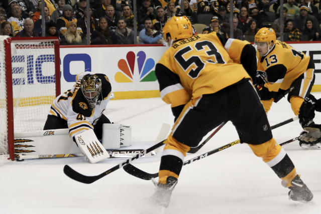Boston Bruins goaltender Jaroslav Halak (41) keeps the puck out of the net as Pittsburgh Penguins' Teddy Blueger (53) and Brandon Tanev (13) look for a rebound during the second period of an NHL hockey game, Sunday, Jan. 19, 2020, in Pittsburgh. (AP Photo/Keith Srakocic)