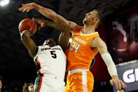 Tennessee forward Uros Plavsic (34) blocks a shot from Georgia's Anthony Edwards (5) during the first half of an NCAA college basketball game Wednesday, Jan. 15, 2020, in Athens, Ga. (Joshua L. Jones/Athens Banner-Herald via AP)