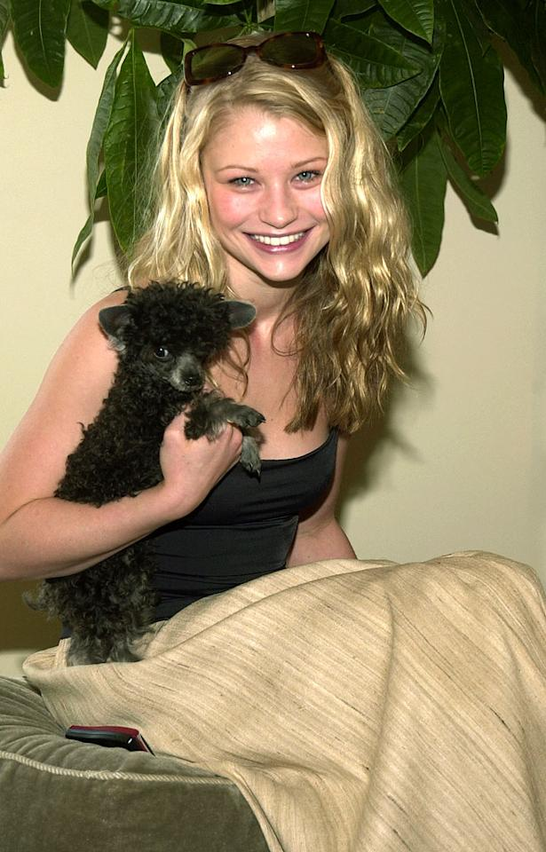 "Emilie de Ravin and her dog Bella. Jean-Paul Aussenard/<a href=""http://www.wireimage.com"" target=""new"">WireImage.com</a> - March 22, 2002"