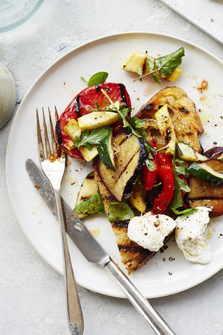 """<p> The iconic French vegetable dish is reimagined into a delightfully tasty salad with this easy-to-follow recipe. Topped off with fresh mozzarella, you'll be savoring every bite.</p><p><a href=""""https://www.womansday.com/food-recipes/food-drinks/recipes/a59407/ratatouille-salad-recipe/"""" rel=""""nofollow noopener"""" target=""""_blank"""" data-ylk=""""slk:Get the Ratatouille Salad recipe."""" class=""""link rapid-noclick-resp""""><em>Get the Ratatouille Salad recipe.</em></a></p>"""