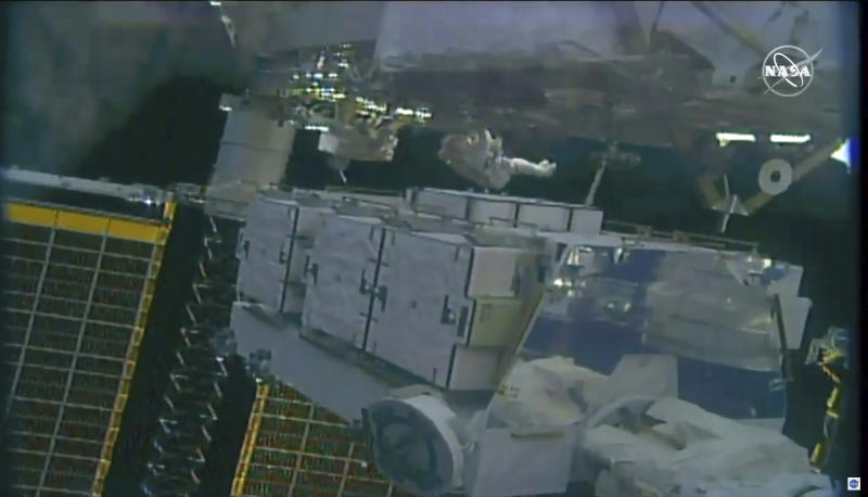 In this image taken from NASA video NASA astronauts Jessica Meir and Christina Koch work to finish upgrades to the International Space Station's power grid, Wednesday, Jan. 15, 2020.  It was the second pairing of Meir and Koch outside the orbiting lab. (NASA via AP)