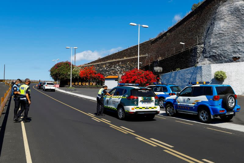 Police and civil guard members stand by as authorities on the Spanish Canary Island of La Palma are on alert for volcanic eruption, in La Palma