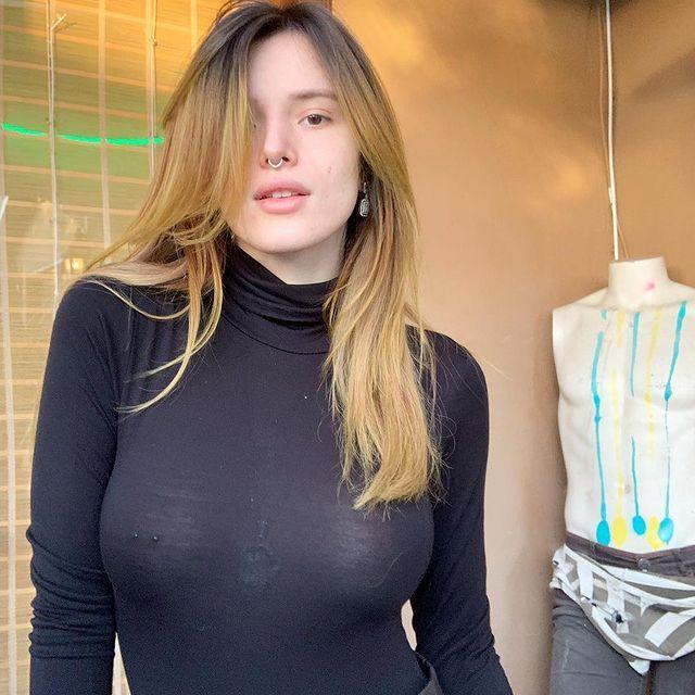 """<p>Bella Thorne shared her no-makeup vibes and nipple ring with the world when she posted this photo on her Instagram account. It features her in a sheer, black turtleneck posing in front of a... mannequin? She captioned the pic: """"No make up😍😍 working on my skin line currently!!"""" Bella has said the she will be launching a makeup brand called DSL at some point in 2019.</p><p><a href=""""https://www.instagram.com/p/BtEhP0wF3k6/?utm_source=ig_embed&utm_medium=loading"""" rel=""""nofollow noopener"""" target=""""_blank"""" data-ylk=""""slk:See the original post on Instagram"""" class=""""link rapid-noclick-resp"""">See the original post on Instagram</a></p>"""
