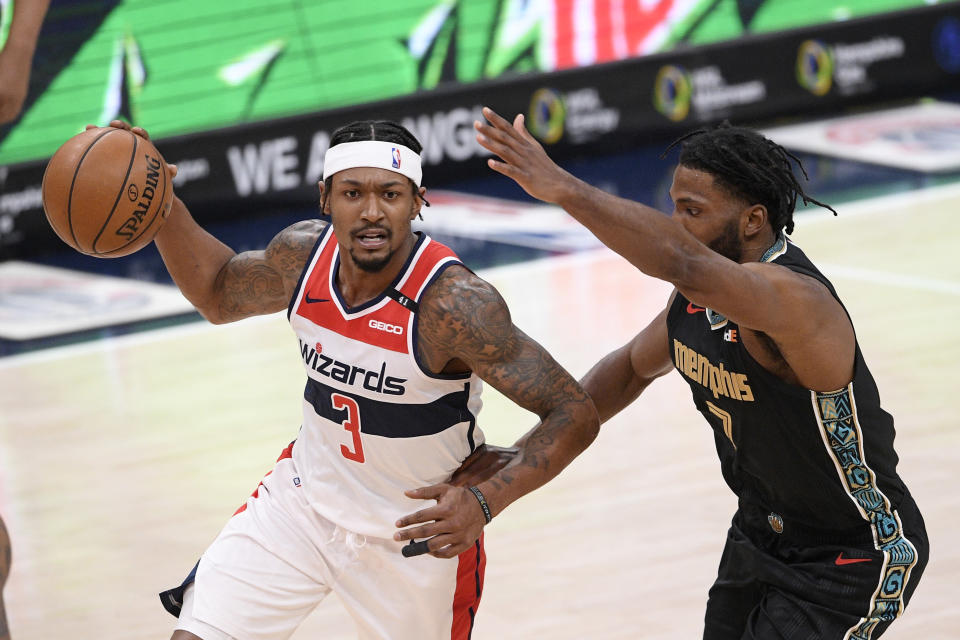 Washington Wizards guard Bradley Beal (3) dribbles the ball against Memphis Grizzlies forward Justise Winslow (7) during the second half of an NBA basketball game, Tuesday, March 2, 2021, in Washington. (AP Photo/Nick Wass)