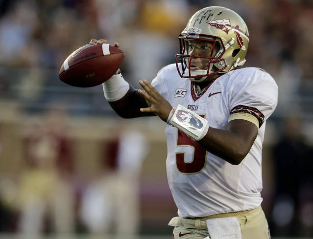 Florida State quarterback Jameis Winston (5) throws a pass during the second half of an NCAA college football game against Boston College in Boston, Mass., Saturday, Sept. 28, 2013. Florida State defeated Boston College 48-34. (AP Photo/Stephan Savoia)