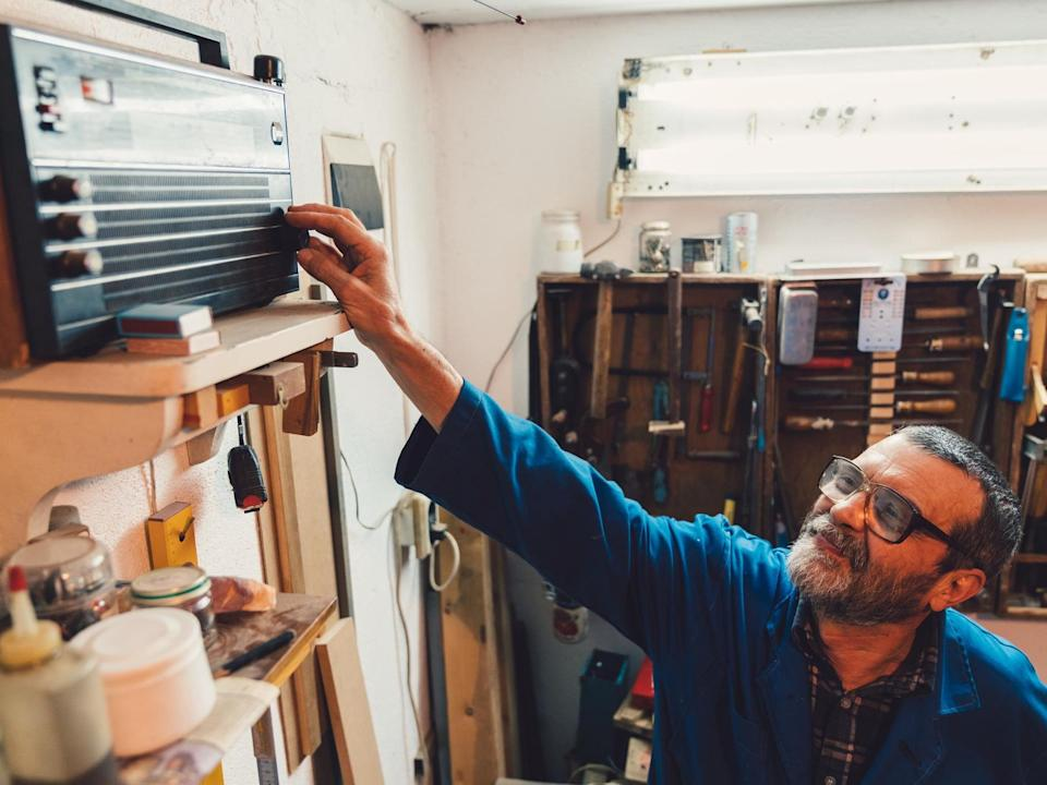Carpenter at the workshop plays the radio: Getty
