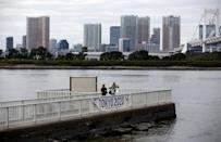 Visitors stroll at Odaiba Marine Park, the venue for Marathon Swimming and Triathlon events during the Tokyo 2020 Games, in Tokyo, Japan October 4, 2017. REUTERS/Issei Kato