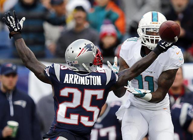 New England Patriots cornerback Kyle Arrington (25) breaks up a pass intended for Miami Dolphins wide receiver Mike Wallace (11) in the third quarter of an NFL football game Sunday, Oct. 27, 2013, in Foxborough, Mass. (AP Photo/Michael Dwyer)