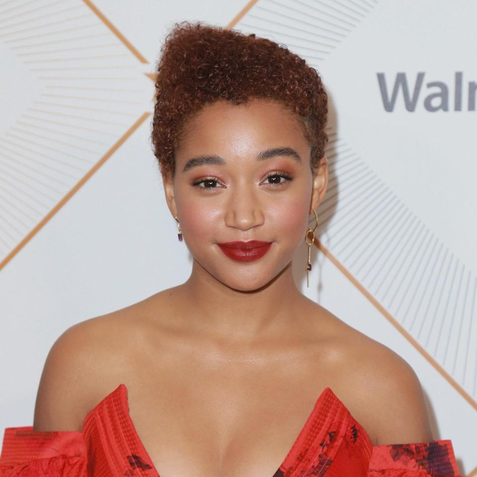 """<p>Looking for more of an unconventional style like Amandla Stenberg's? At the salon, """"ask for an asymmetrical high-top fade shaping at the top, keeping about one-and-a-half- to two-inches of length on the sides to allow your curls to naturally flow into sides and back,"""" says James.</p> <p>Styling notes: use a <a href=""""https://www.allure.com/gallery/best-curl-creams-under-20?mbid=synd_yahoo_rss"""" rel=""""nofollow noopener"""" target=""""_blank"""" data-ylk=""""slk:curl cream"""" class=""""link rapid-noclick-resp"""">curl cream</a> for a soft finish and touchable hold. """"Apply an ample amount at your fingertips, rub together in the palms of your hands, and work it throughout your hair from root to ends, directing the curls to one side,"""" she says. """"For distinct definition, finger coil around the perimeter and at the top on various pieces for a more polished look."""" To balance it out, opt for a strapless dress and mismatched earrings.</p>"""