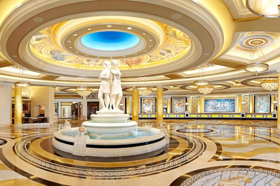 """<p><strong>How did it strike you on arrival?</strong><br> The best thing about arriving at the Augustus and Octavius tower rooms is that they have their own entrance, on Flamingo, far away from the crowds of the Strip. You can valet there and go right to registration, as opposed to the Forum and Julius towers (and even the hotel-within-hotel that is <a href=""""https://www.cntraveler.com/hotels/las-vegas/nobu-hotel?mbid=synd_yahoo_rss"""" rel=""""nofollow noopener"""" target=""""_blank"""" data-ylk=""""slk:Nobu"""" class=""""link rapid-noclick-resp"""">Nobu</a>), where you have to come into the chaotic main entrance. It's all light colors and modern lines in Augustus (no centurions taking selfies with margarita swilling tourists here!), and you won't even be close to a casino floor, so it feels very calm.</p> <p><strong>What's the crowd like?</strong><br> The travelers who are Augustus regulars know exactly what they want from the 4,000-room Roman extravaganza that is Caesars. Each tower is different, and Augustus is one of the newest constructions (and recently renovated). The rooms are spacious, and though the newer Octavius tower is considered to be an upgrade, it actually takes longer to walk to Octavius from the main entrance and the casino. Those who bypass Octavius for Augustus know this. They're generally well-informed frequent visitors to Vegas who either do business here or gamble here frequently. Where it can take a lot of time in other parts of the resort just to locate coffee, there's a Starbucks just off the lobby here and it all feels much better planned.</p> <p><strong>The good stuff: Tell us about your room.</strong><br> Caesars is constantly renovating, and its largest tower—the Palace Tower (with 1,181 rooms) got a $100 million reno just a few years back. Those looking for a splurgy trip should go straight for the 29th-floor villa suites, which, like the grand villas in the Octavius and Augustus towers, are massive and full of great (and OTT) design details. The centrally loca"""