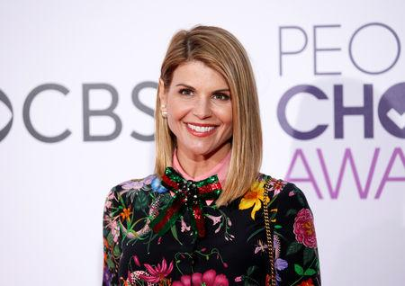 FILE PHOTO: Actress Lori Loughlin arrives at the People's Choice Awards 2017 in Los Angeles