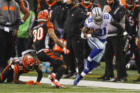 Dallas Cowboys running back Ezekiel Elliott (21) tries to stay in bounds as he's pursued by Cincinnati Bengals free safety Jessie Bates (30) in the second half of an NFL football game in Cincinnati, Sunday, Dec. 13, 2020. (AP Photo/Aaron Doster)