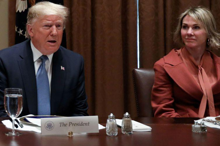 FILE PHOTO: U.S. President Donald Trump — with full-sized salt and pepper shakers — is flanked by U.S. Ambassador to the United Nations Kelly Craft, with the smaller salt and pepper shakers used by Trump's guests, as he hosts a lunch for