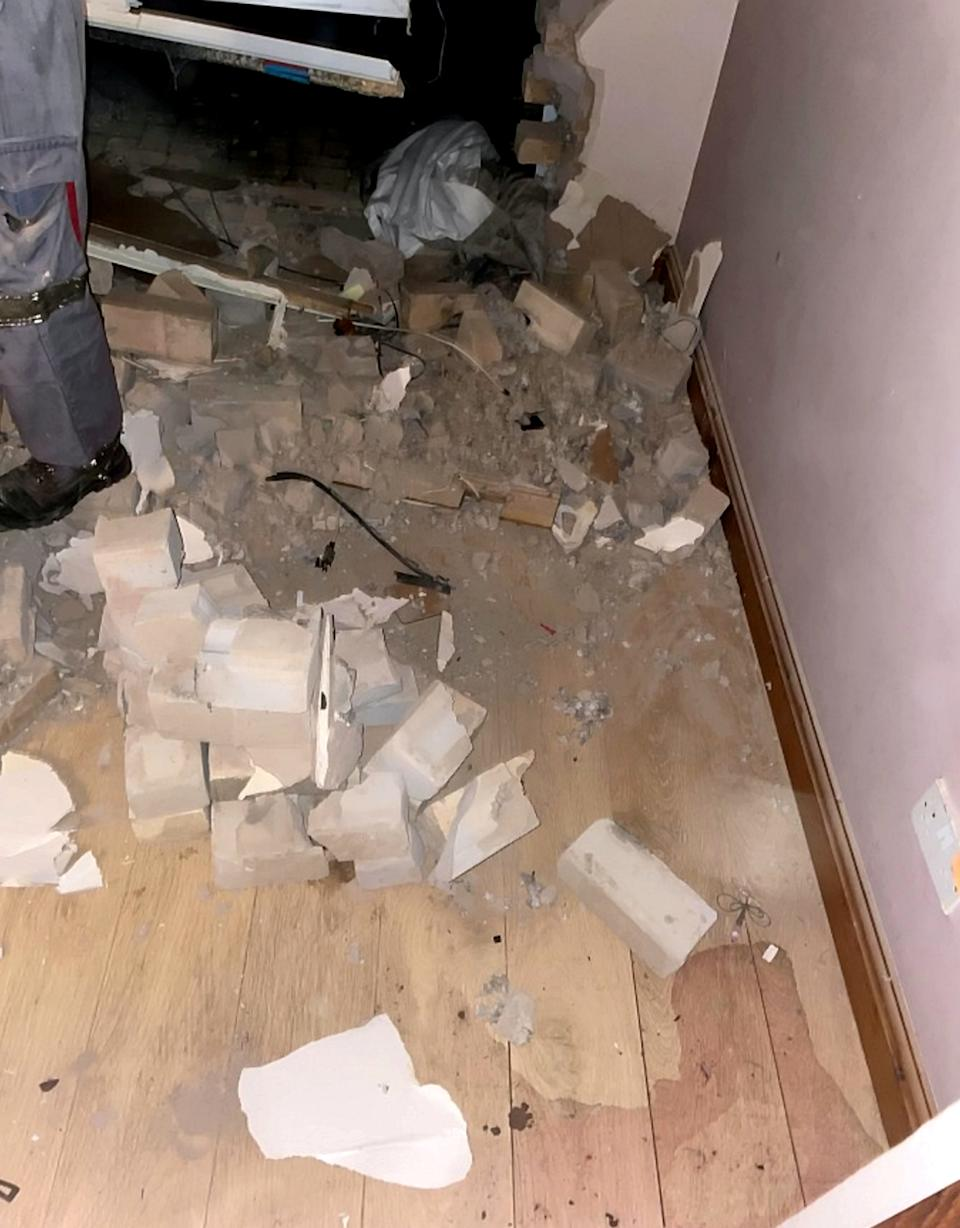 Ms Brindley was uninjured in the crash that destroyed her living room. (SWNS)