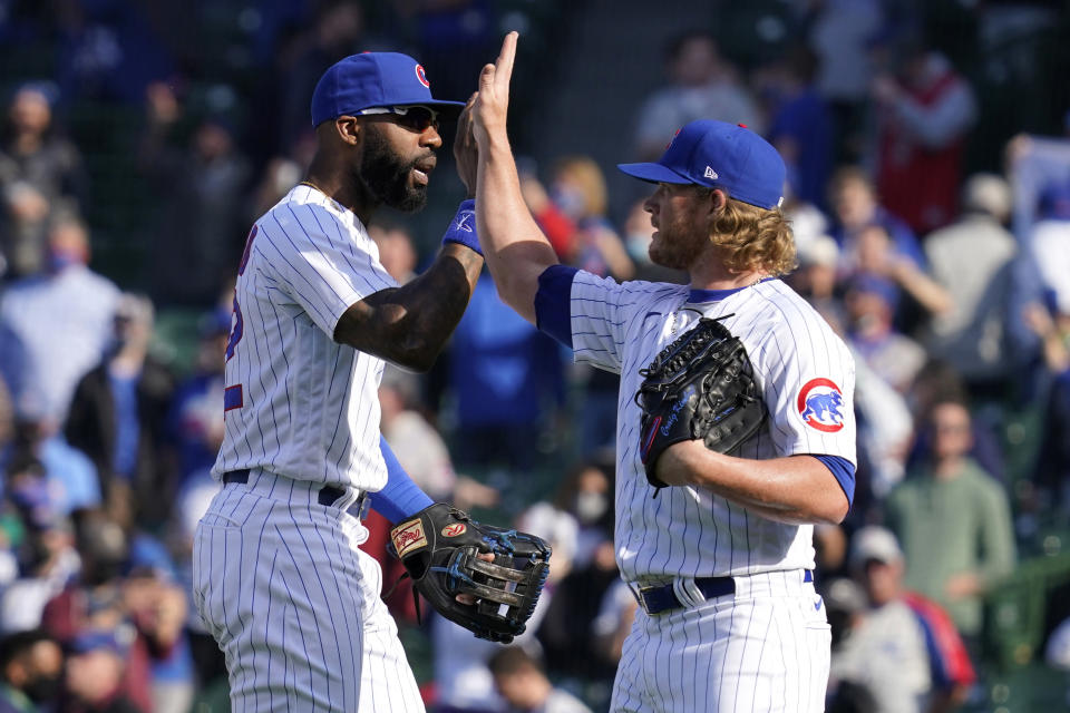 Chicago Cubs right fielder Jason Heyward, left, celebrates with relief pitcher Craig Kimbrel after they defeated the Pittsburgh Pirates in a baseball game in Chicago, Saturday, April 3, 2021. (AP Photo/Nam Y. Huh)