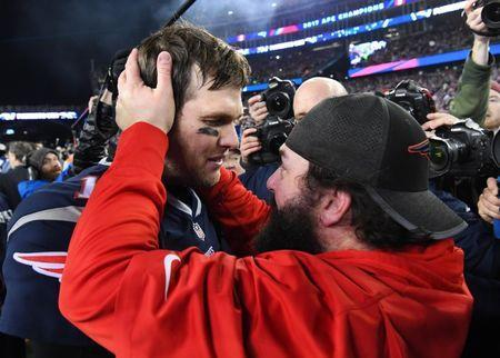 Jan 21, 2018; Foxborough, MA, USA; New England Patriots quarterback Tom Brady (12) greets defensive coordinator Matt Patricia after defeating the Jacksonville Jaguars in the AFC Championship Game at Gillette Stadium. Mandatory Credit: Robert Deutsch-USA TODAY Sports