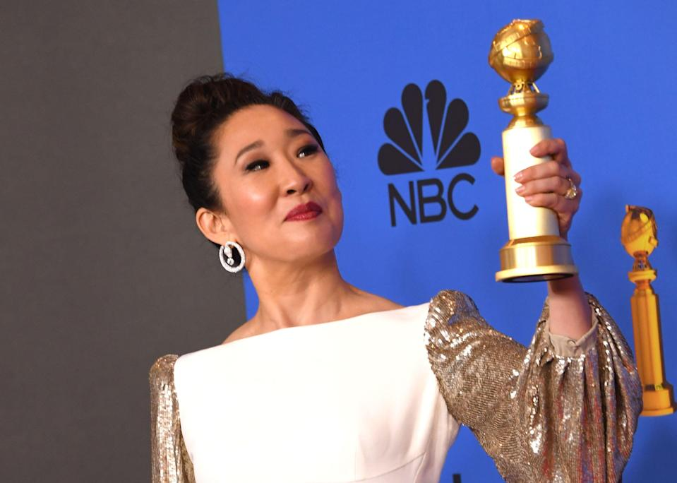 Host and Best Performance by an Actress in a Television Series Drama 'for Killing Eve' winner Sandra Oh poses with the trophy during the 76th annual Golden Globe Awards on January 6, 2019, at the Beverly Hilton hotel in Beverly Hills, California. (Photo by Mark RALSTON / AFP) (Photo credit should read MARK RALSTON/AFP/Getty Images)