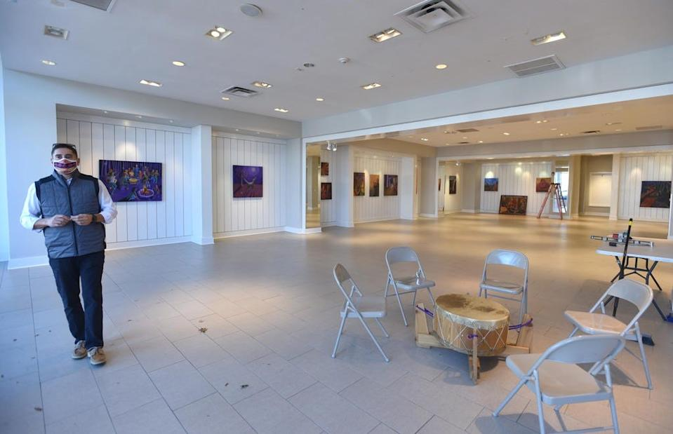 Steven Peters, a spokesperson for the Mashpee Wampanoag Tribe, stands in a gallery opened for Native American Heritage on Month on Nov. 4, 2020. The Wampanoag Trading Post and Gallery in Mashpee Commons features an exhibit of artwork and movies about the Mashpee tribe.