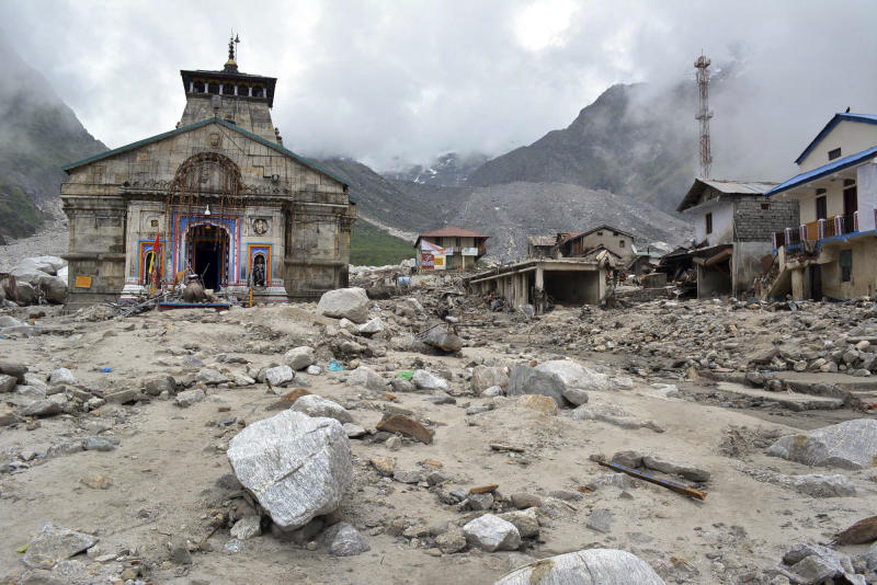 In this Thursday June 20, 2013 photo, the Kedarnath shrine, one of the holiest of Hindu temples dedicated to Lord Shiva, and other buildings around it are seen damaged following monsoon rains in at Kedarnath in the northern Indian state of Uttrakhand. A joint army and air force operation are trying to evacuate thousands of people stranded in the upper reaches of the state of Uttrakhand where days of rain had earlier washed out houses, temples, hotels and vehicles leading to deaths of over a hundred people amid fears that the death toll may rise much higher. (AP Photo)