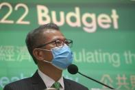 Hong Kong Finance Minister Paul Chan attends a news conference on budget for 2021-22 in Hong Kong, Wednesday, Feb, 24, 2021. Hong Kong will introduce 120 billion Hong Kong dollars ($15.4 billion) in fiscal measures to help businesses and residents impacted by the coronavirus pandemic, as it looks towards economic growth later this year following a recession in 2020. (AP Photo/Kin Cheung)