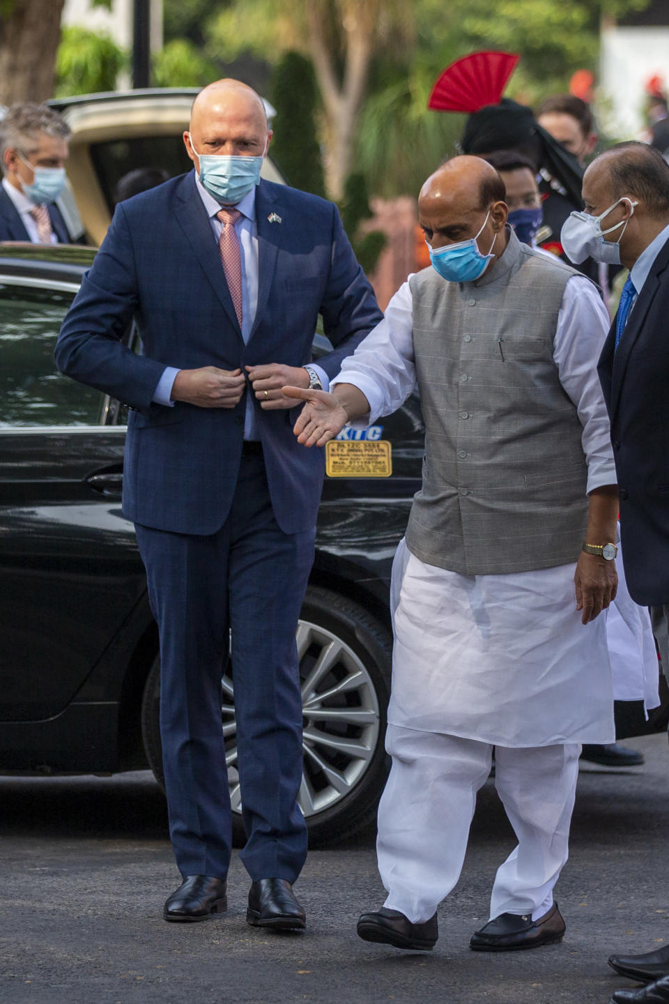 Indian Defense Minister Rajnath Singh, right, welcomes his Australian counterpart Peter Dutton as he arrives for a Guard of Honor in New Delhi, India, Friday, Sept. 10, 2021. India on Friday sought investment from Australia's defense industry as the two countries discussed steps to bolster defense ties and cooperation on maritime security in the Indo-Pacific region with China flexing its muscles in the region. (AP Photo/Altaf Qadri)