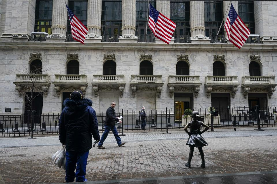 FILE - In this Feb. 16, 2021 file photo, pedestrians pass the New York Stock Exchange in New York. Stocks were slightly higher in early trading Friday, April 9, as a rise in bond yields helped lift the shares of energy and bank companies in the early going. (AP Photo/Frank Franklin II, File)