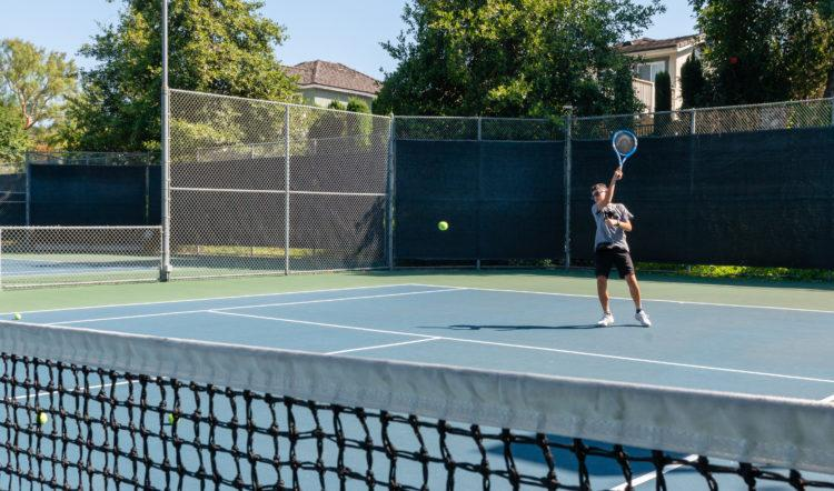 While at tennis practice, Sam wears a fanny pack around his waist that holds his insulin pump, cellphone and a credit-card-sized device that transmits commands to the pump.