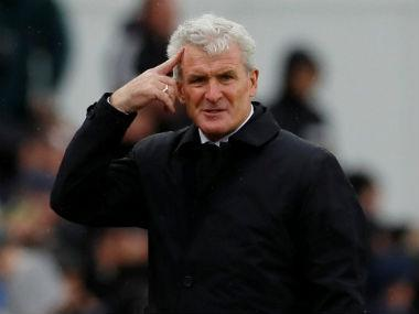 Southampton manager Mark Hughes has signed a new three-year contract after keeping them in the Premier League last season, the south-coast club said on Friday.