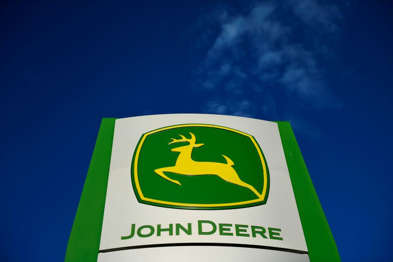 FILE PHOTO: The leaping deer trademark logo is seen on a sign outside a John Deere dealership in Taylor, Texas