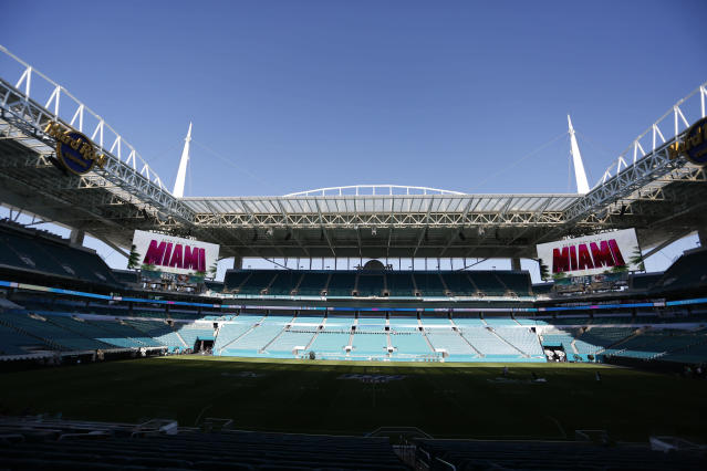 """Scoreboards display """"Super Bowl LIV Miami"""" during a tour of Hard Rock Stadium on Tuesday, Jan. 21, 2020, ahead of the NFL Super Bowl LIV football game in Miami Gardens, Fla. (AP Photo/Brynn Anderson)"""