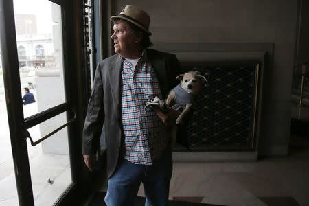 """Frida, a female Chihuahua, is carried into City Hall by owner Dean Clark before the San Francisco Board of Supervisors issues a special commendation naming Frida """"Mayor of San Francisco for a Day"""" in San Francisco, California November 18, 2014. REUTERS/Stephen Lam"""
