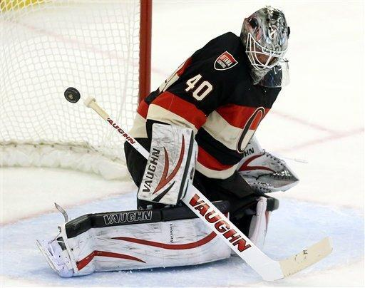 Ottawa Senators goaltender Robin Lehner makes a save against the Tampa Bay Lightning during the second period of an NHL hockey game in Ottawa, Ontario on Saturday, March 23, 2013. (AP Photo/The Canadian Press, Fred Chartrand)