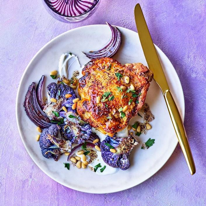 <p>Cauliflower has gone full technicolor, leaping from white to bright orange, neon green and--you guessed it--purple. The roast chicken in this recipe gets its hue from a marinade that's seasoned with tangy sumac.</p>