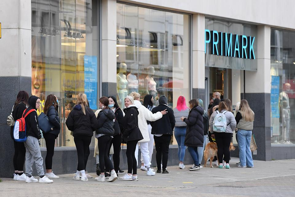 <p>'What is it about the sight of ordinary people standing quietly outside a shop known for cheap clothing that makes some people react this way? Is it poverty itself we fear so much?'</p> (Getty Images)