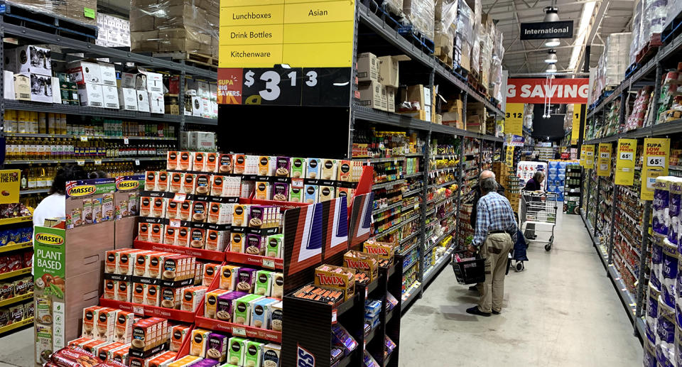The new-look IGA boasts wide aisles and low prices.