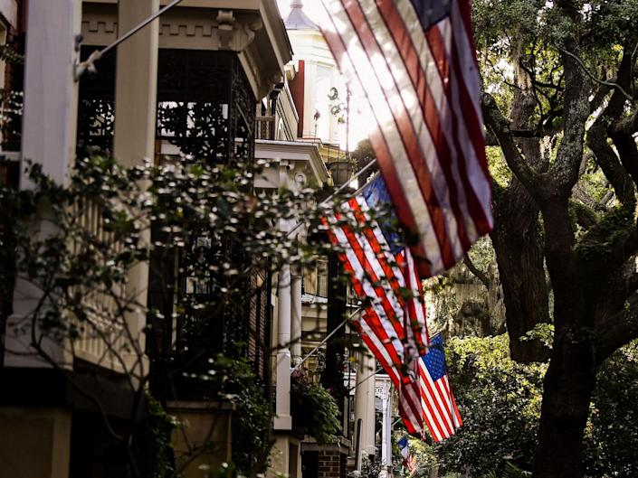People walk around the Historic District in Savannah, Georgia, amid the novel coronavirus pandemic on 25 April 2020: (2020 Getty Images)