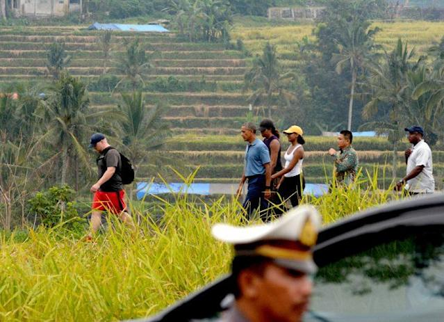 President Barack Obama, First Lady Michelle Obama, and First Daughter Sasha Obama touring the Balinese rice fields in Indonesia.(Photo: Getty Images)