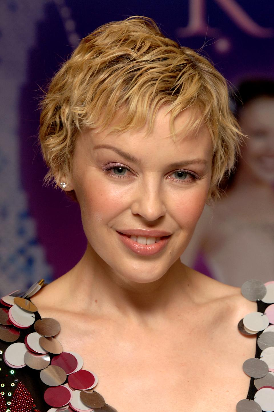 Singer Kylie Minogue with copies of her new book, The Showgirl Princess, during a book signing session at Waterstone's in London.