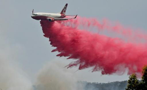 Planes and helicopters were used to splatter a built-up neighbourhood with water and red retardant