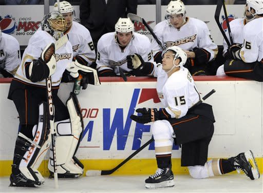 Anaheim Ducks' Ryan Getzlaf (15) watches a replay of his disallowed goal with goaltender Jonas Hiller, left, of Switzerland, during the overtime period of an NHL hockey game against the New Jersey Devils Friday, Feb. 17, 2012, in Newark, N.J. The Devils defeated the Ducks 3-2 in a shootout. (AP Photo/Bill Kostroun)